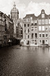 Amsterdam canal with houses and St. Nicholas Church
