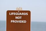 Lifeguards not provided sign poster