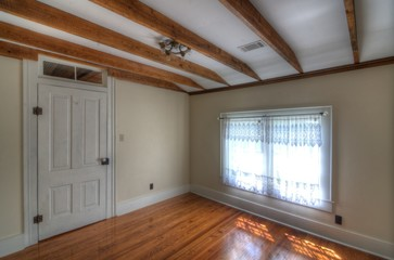 Small Room WIth Wooden Beams on Ceiling