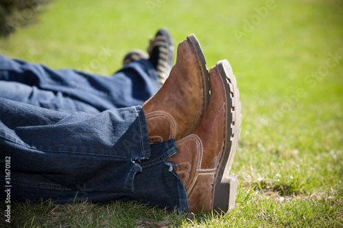 cowboy boots brown crossed feet