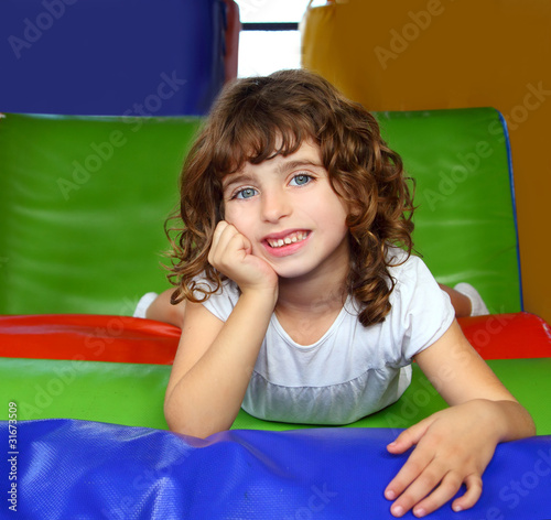 brunette little girl portrait posing in playground