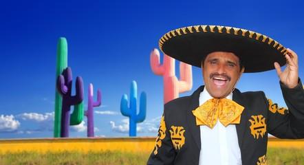 Mexican mariachi charro singing in cactu