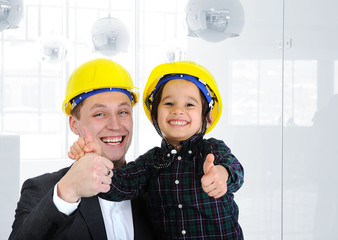 Happy boss and employee together, father and son