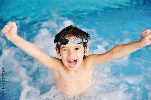 Leinwandbild Motiv Activities on the pool, children swimming