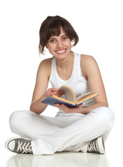 Girl sitting on the floor and reading book