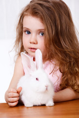 Girl and a white rabbit