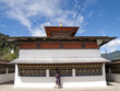 buddhist man spinning the prayer wheels in Bhutan