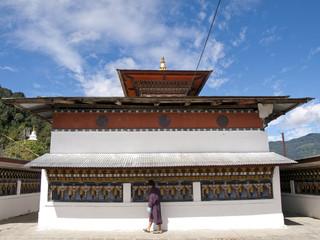 buddhist man spinning the prayer wheels in Bhutan