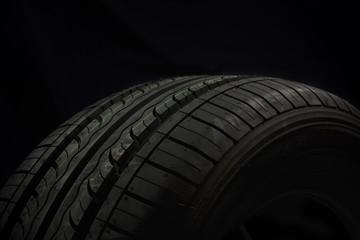 Car tire on black background