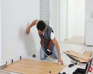 Laborer laying laminate floor