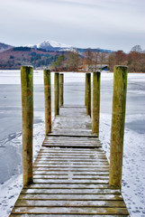 Jetty on frozen lake
