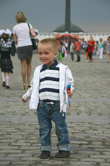 Victory day in Moscow. Boy with flag on square