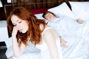 couple in disagreement in bedroom