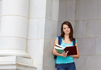 young woman reading on school campus
