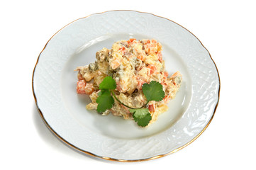 Olivier salad of potatoes, carrots, meat, peas, pickles, eggs is