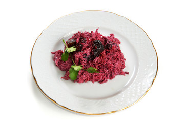 Beetroot salad with prunes and mayonnaise isolated