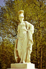 greek statue in a park vintage camera