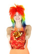 young beauty woman in multicolored clown wig smiling and stretch