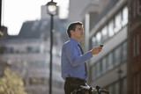 A businessman checking directions using his mobile phone