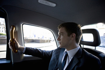 Portrait of a businessman in a taxi