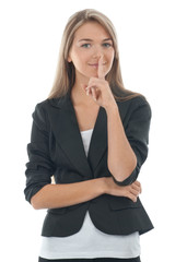Portrait of pretty young businesswoman with finger on lips