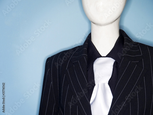 faceless dummy model dressed in business suit and tie