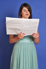 choir girl singing from sheet music