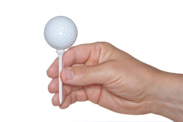A golf ball on tee in hand isolated on white.