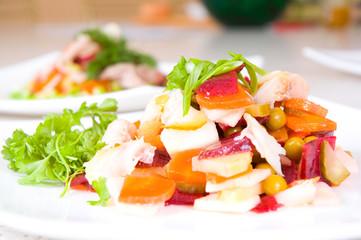 salad of beetroot, carrot, potato, green leek and fish