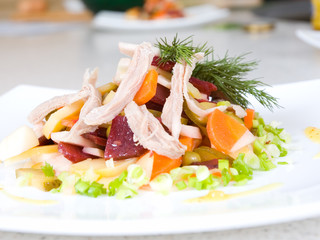 salad of beetroot, carrot, potato, green leek and meat