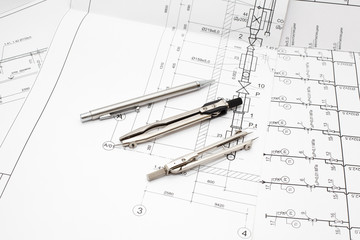 Drafting instruments on project blueprints