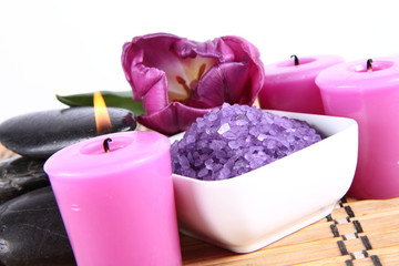 Lavender spa salt, spa stones, candles and a tulip flower