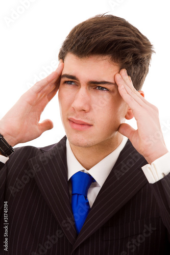 Young Business man in agony with a headache, isolated on white