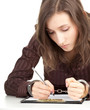 writing serious young woman with handcuffed hands