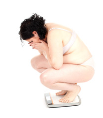 squats on scale young fat woman in underwear