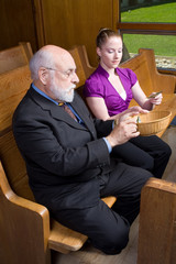 Older Man Young Woman Donating Church Offering