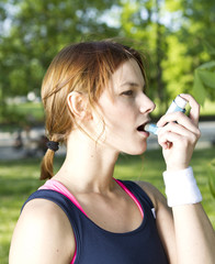 Young girl with asthma inhalator