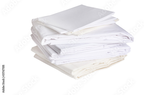 pile of ironed white bed sheets