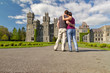 Couple in hug looking to the idyllic Ashford castle