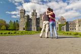 Couple in hug looking to the idyllic Ashford castle