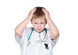 Worried child with doctor uniform