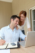Self-employed man working at home with wife