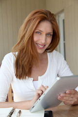 Woman working at home with electronic tablet