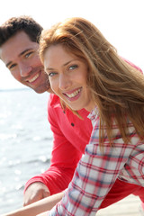 Portrait of smiling couple standing by a lake