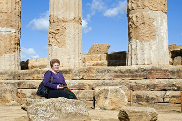 Guide posing near Temple of  Heracles, Valley of Temples, Sicily