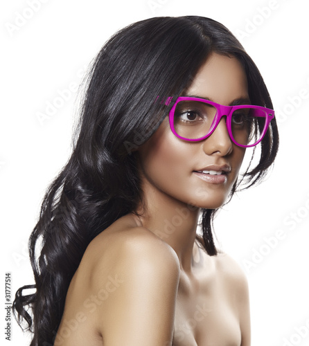 pink glasses on beautiful tanned woman.