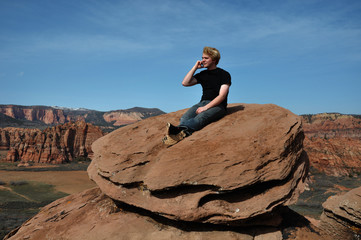 Teenage Boy Talking on Cell Phone In Zion