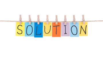 Solution, words hang by wooden peg