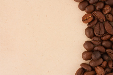 Coffee beans on old paper background