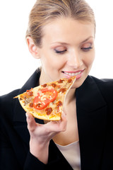 Young happy businesswoman eating pizza, isolated on white